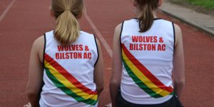 Two girls wearing club vests